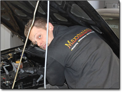 Natanael changing ignition coils on customer car.
